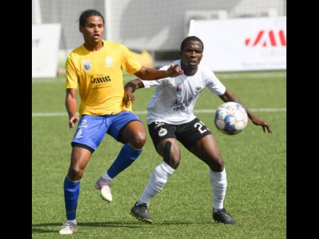 Cavalier goalscorer Bryan English (right) duels for the ball with Harbour View's Casseam Priestly during their Jamaica Premier League game at the UWI/JFF/Captain Horace Burrell Centre of Excellence yesterday.