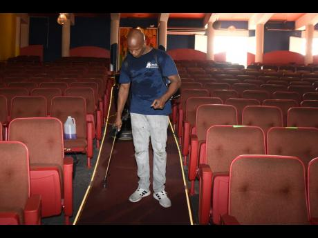 Manpower and Maintenance Services Limited's Authur Able assists with the cleaning of the Little Theatre.