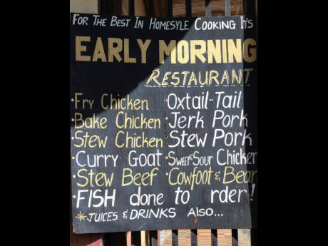 A menu at the entrance of Cross Road Shopping Centre hints at a restaurant inside.