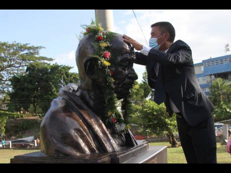 Rungsung Masakui, India's high commissioner to Jamaica, participates in the unveiling of a bust of Mahatma Gandhi in May Pen, Clarendon, on Wednesday.