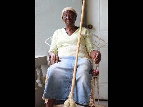 Dezeta Ranger is one of the eldest, and few women in Canaan Heights, who developed a special way of sewing the wire into the silver thatch used to make house brooms.
