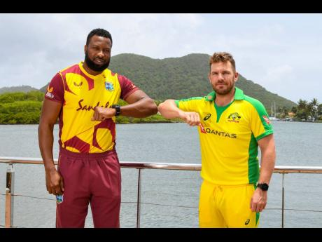 West Indies captain Kieron Pollard (left) stands with his Australian counterpart Aaron Finch, yesterday, a day before the start of their five-match Twenty20 International series in St Lucia.