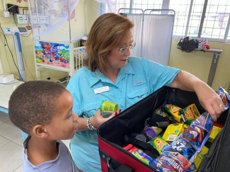 New school supplies make for very happy patients in the hospital and for students in school. Through the Issa Trust Foundation and Couples Resorts, Diane Pollard (right) says persons can pack to make a difference and improve the lives and education for Jam