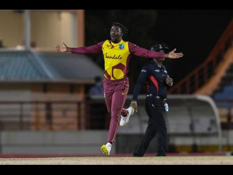 West Indies bowler Hayden Walsh Jr celebrates after taking a wicket against Australia in their first of five Twenty20 International matches. the game was played in St Lucia on Friday.