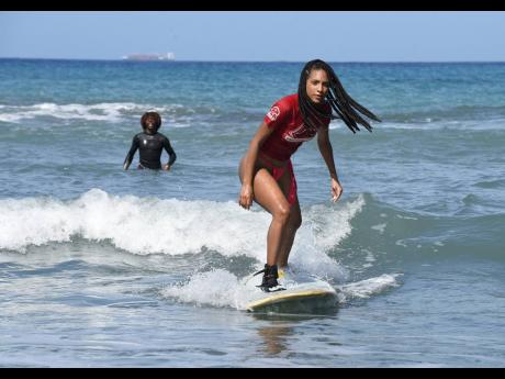 With her surf trainer Frogboss keeping a watchful eye in the background, Naomi Cowan caught a wave. It's a feat, she says, made her feel accomplished and free. With her surf trainer Frogboss keeping a watchful eye in the background, Naomi Cowan caught a