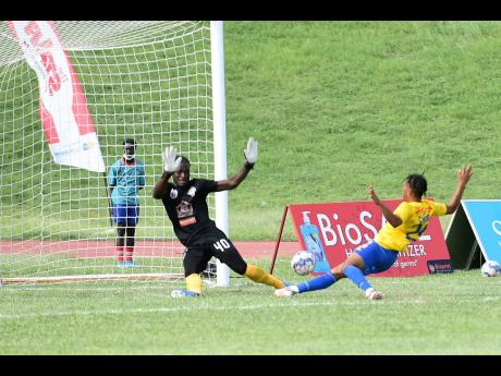 Mount Pleasant goalkeeper David Swaby is beaten by a redirected tap in from Harbour View's Oquassa Chong (right) during their Jamaica Premier league game at Stadium East in St Andrew yesterday.