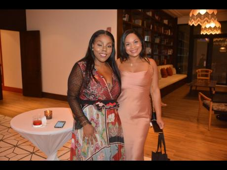 Keanna Sanders (left), chief executive officer, Sanbridge Early Learning Centers, and Kheri-Ann Yong, director of operations at premium cigar manufacturing company Fire Lyfe, at a cocktail reception at the Ocean Coral Spring in Trelawny.
