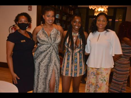 Shaunise Williams (second right), process engineer at Ford, and real estate agent Trisha Jackson (second left) share lens time with Odette Dyer (right), Jamaica Tourist Board regional manager, and Tanesha Clarke, marketing and sales director, Ocean Coral S