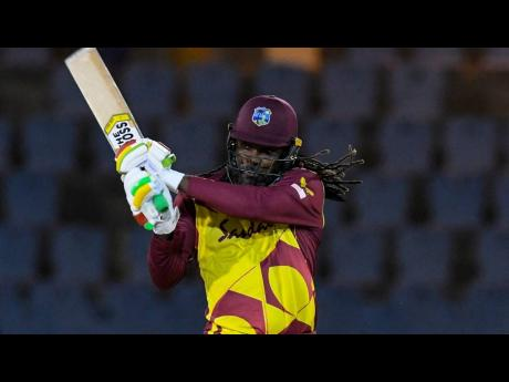 West Indies batsman Chris Gayle on his way to a milestone 14,000 Twenty20 (T20) International runs. He achieved the feat in the third T20 match of the five-game series against Australia in Gros Islet, St Lucia on Monday.