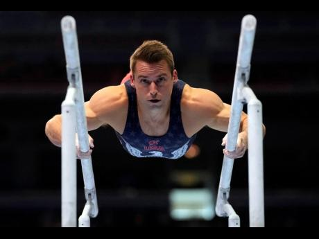 Sam Mikulak competes on the parallel bars during the men's US Olympic Gymnastics Trials in St Louis, Missouri, on Saturday, June 26.