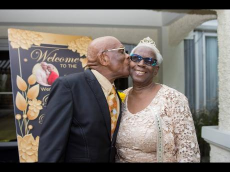 A kiss for the happy wife.