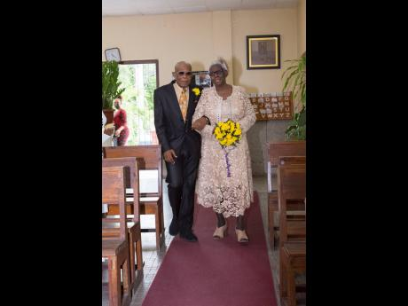 Fifty years after saying 'I do', Pastor Pauline and Bishop Rupert Stephenson make their way down the aisle to renew their vows.