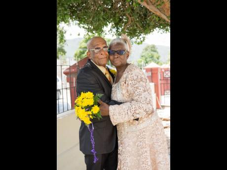 The contented couple share a warm embrace at their recent vow renewal ceremony at the Faith Temple in Kingston