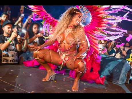 Fitness professional and social media sensation Qimmah Russo from New York tore up the stage of the popular M3 Studios in GenX Carnival's Athena frontline costume. It is created by Miami swimwear designer Lila Nikole.