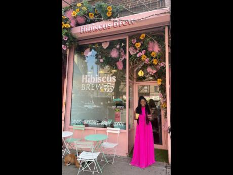 Allison Dunn in front of her colourful Hibiscus Brew café in Brooklyn, New York.