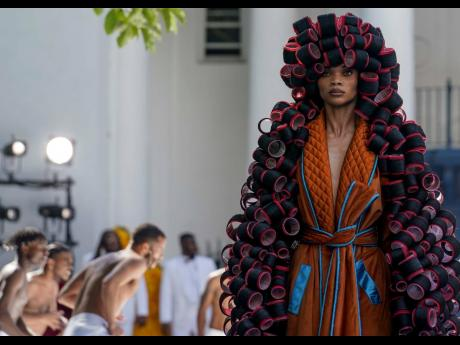 The hair curler outfit alone, Kerby Jean-Raymond said, took months because 'it was just people sitting there and curling real weaves on to hair rollers'.
