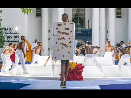 Tami Williams thanked 'the very first black American designer to show at Paris Couture week' in a post on Instagram. 'A big thank you and congratulations to you, Kerby [Jean-Raymond], and your entire team. The results speak for itself. The hard work