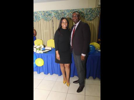 Immediate past president of the Rotary Club of Mandeville, Dr Garth Anderson (right), and his wife, Tracey Ann, were a hot number for the celebration.