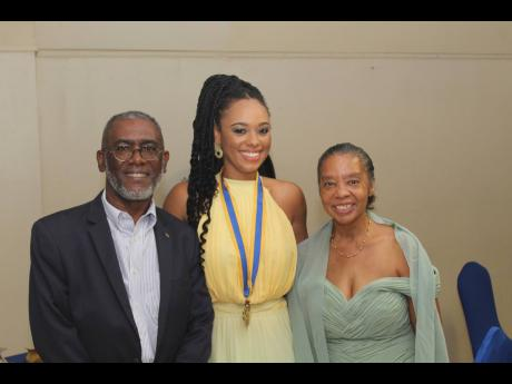 The new Rotary Club of Mandeville president, Dr Kimberly Freeman, flanked by her parents Linval (left) and Donna Freeman.