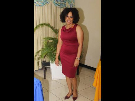 Rotarian Charmaine Grant made a bold statement in burgundy for the installation of her new president, Dr Kimberly Freeman.