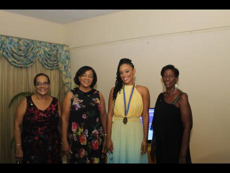 Incumbent Dr Kimberly Freeman (second right) with former women presidents of the Rotary Club of Mandeville (from left), Dale Greaves Smith, Pauline Channer, and Karleen Kelly Reid.