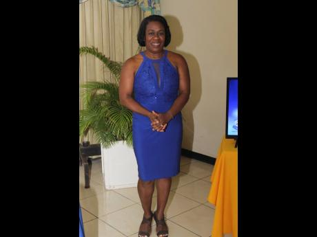 General manager of Barita Investments, Mandeville, Vanessa Williams, was royal in blue for her guest speaker duties.