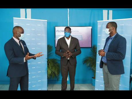 Jasford Gabriel (left), president, Jamaica Teachers' Association (JTA), discusses the next steps with Stephen Price (centre), chairman, FLOW Foundation, and Ricardo Allen (right), president and CEO,One-on-One Educational Services, during a light moment a