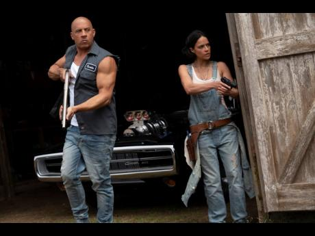 Vin Diesel (left), and Michelle Rodriguez in a scene from 'F9: The Fast Saga'.