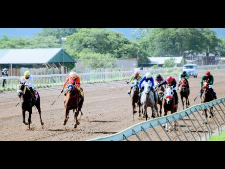 Silver Tapp (left), ridden by Bebeto Harvey, wins the fifth race over seven furlongs at Caymanas Park on Monday.