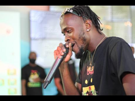 Laa Lee performs at the Digicel Ocean Boulevard Headquarters last Wednesday for the official launch of the telecommunications company's 'Mek Wi Rich Togeddah' summer promotion.