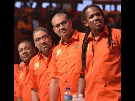 Former PNP chairman Phillip Paulwell and former PNP vice presidents (from left), Wykeham McNeil, Mikael Phillips, Damion Crawford during the PNP's 80th anniversary conference.