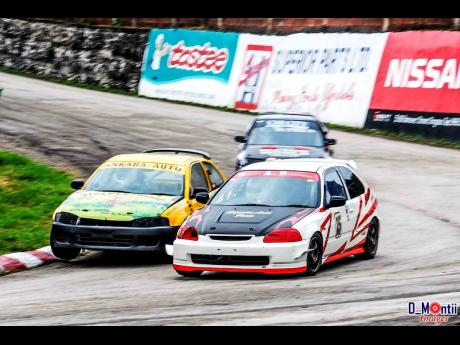 Vivian Mitchell fending off the challenge of Sebastien Rae and his Mivec, in the famous Corner three at Dover Raceway.