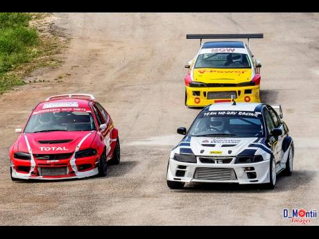Gary Williams in his Evo leads Andre Anderson and Heath Causwell into Corner three at Dover Raceway.