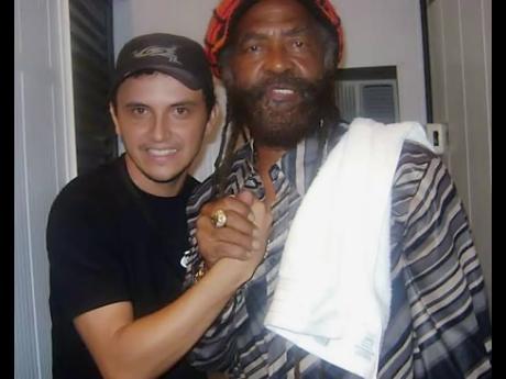 DJ Waldiney (left) and John Holt.