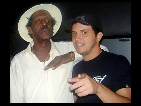 2. DJ Waldiney (right), and Gregory Isaacs. When 'The Sunday Gleaner' spoke with DJ Waldiney, he was wearing an Isaacs T-shirt because he was celebrating the July 15 birthday of reggae's 'Cool Ruler'.