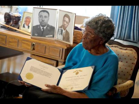 World War II veteran Maj Fannie Griffin McClendon pauses while speaking about her past at her home in Tempe, Arizona. McClendon had a storied history as a member of the 6888th Central Postal Directory Battalion that made history as being the only all-fema