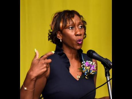 Diahann Gordon Harrison, children's advocate, speaks at the Kiwanis Club of New Kingston prayer breakfast and awards ceremony at the Police Officers' Club in Kingston last Saturday.