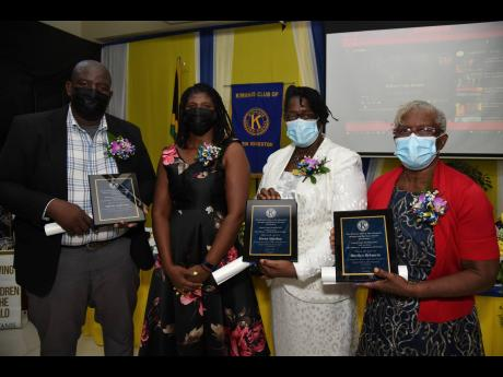 Suzilee McLean-Chambers (second left) president, Kiwanis Club of New Kingston, with awardees from the early- childhood education sector at the club's prayer breakfast on Saturday morning. From left are Meikle Anderson, who collected the award on behalf o