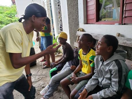 Jaheim Brown, 16, raps with one of the 28 students enrolled in his summer school programme in Yallahs, St Thomas. Students aged four to 23 attend the sessions.