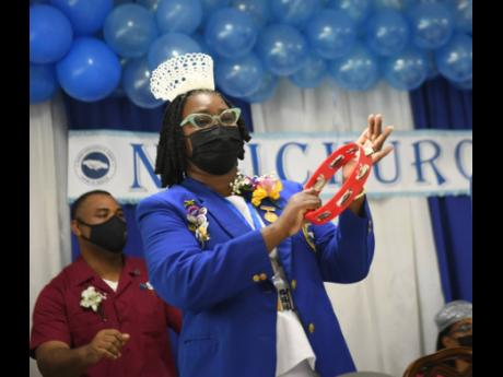 Patsy Edwards-Henry, president of the Nurses Association of Jamaica, rattles a tambourine during praise and worship at the Nurses Week church service held at Mary Seacole House in Kingston on Sunday.