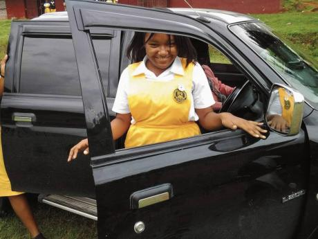 A student of York Castle High School exits a vehicle after a driving lesson.