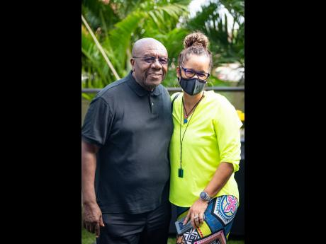 Above: Veteran Jamaican comedian and radio host on The Bridge, Oliver Samuels, is joined by Wendy Duncan for a friendly photo op following his lively on-air interview with Nikki Z.