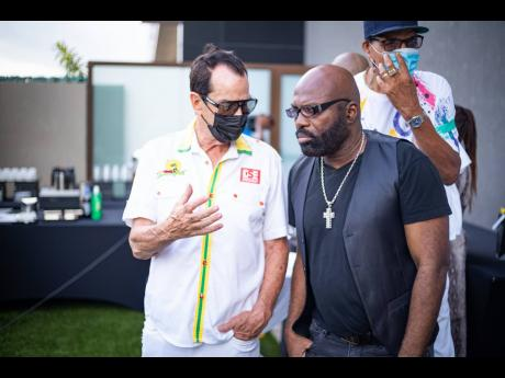 Joe Bogdanovich, Reggae Sumfest executive producer and chairman and CEO of Downsound Entertainment, is caught deep in conversation with veteran reggae artiste Richie Stephens as they participate in The Bridge 99 FM launch broadcast at the AC Marriott Kings
