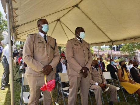 Superintendent of Police Lloyd Darby (left), new commander of the Manchester Police Division, with his predecessor Gary Francis at the changing-of-the-guard ceremony at the Cecil Charlton Park in Mandeville on Monday.