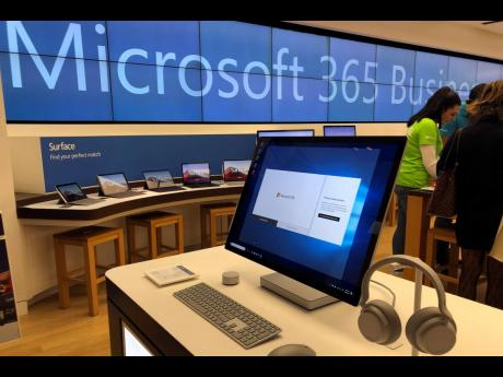 A Microsoft computer is among items displayed at a Microsoft store in suburban Boston.