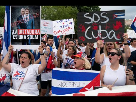 Demonstrators shout their solidarity with the Cuban people against the government during a rally outside the White House in Washington on Saturday, July 17.
