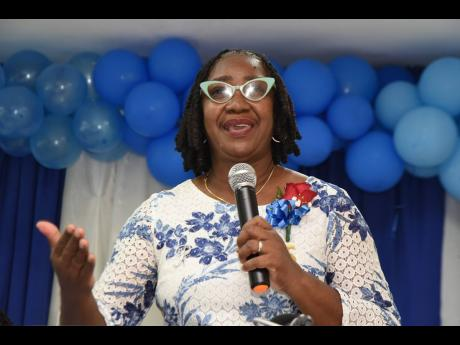 President of the Nurses Association of Jamaica (NAJ) Patsy Edwards-Henry addresses the gathering during an awards ceremony to mark the 75th anniversary of the NAJ at Mary Seacole House in Kingston on Monday.