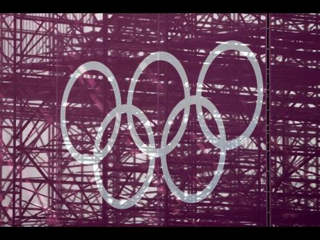 The Olympic rings are set against a lattice work of pipes supporting a grandstand at the skateboarding arena for the 2020 Summer Olympics at the Ariake Urban Sports Park in Tokyo, yesterday.