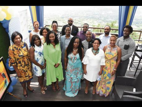 Marie Powell (left), assistant governor for Rotary clubs, Jamaica South-West, shares the moment with the newly installed board of young professionals of the Rotary Club of Trafalgar New Heights in St Andrew, led by Dr Suzanne McDonald Fowles (third left).