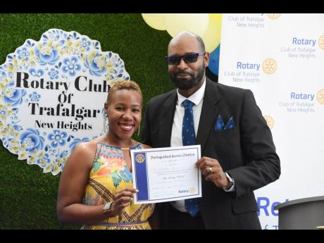 Attorney-at-law Franchesca Francis, past secretary, Rotary Club of Trafalgar New Heights, was named Rotarian of the Year for 2020-2021 for her commitment and perseverance during the pandemic year. Presenting her certificate is president for the 2020-2021 R